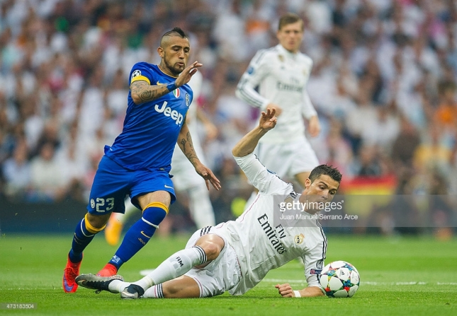 Cristiano Ronaldo of Real Madrid CF duels for the ball with Arturo Vidal of Juventus during the UEFA Champions League semi final match between Real Madrid CF and Juventus at Estadio Santiago Bernabeu on May 13, 2015 in Madrid, Spain.