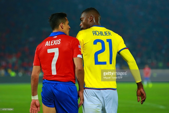 Alexis Sanchez of Chile discusses with Gabriel Achilier of Ecuador during the 2015 Copa America Chile Group A match between Chile and Ecuador at Nacional Stadium on June 11, 2015 in Santiago, Chile.
