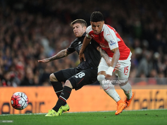 Courtesy of: Getty Images/David Price Alex Oxlade-Chamberlain of Arsenal is challenged by Alberto Moreno of Liverpool during the Barclays Premier League match between Arsenal and Liverpool on August 24, 2015 in London, United Kingdom.