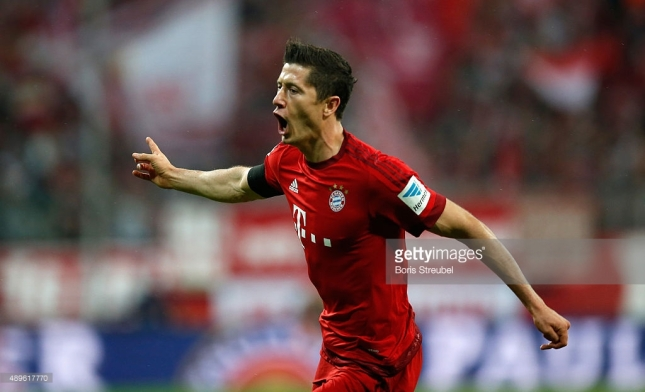 Robert Lewandowski of Bayern Munich celebrates after scoring his second goal during the Bundesliga match between FC Bayern Muenchen and VfL Wolfsburg at Allianz Arena on September 22, 2015 in Munich, Germany. CREDIT: BORIS STREUBEL