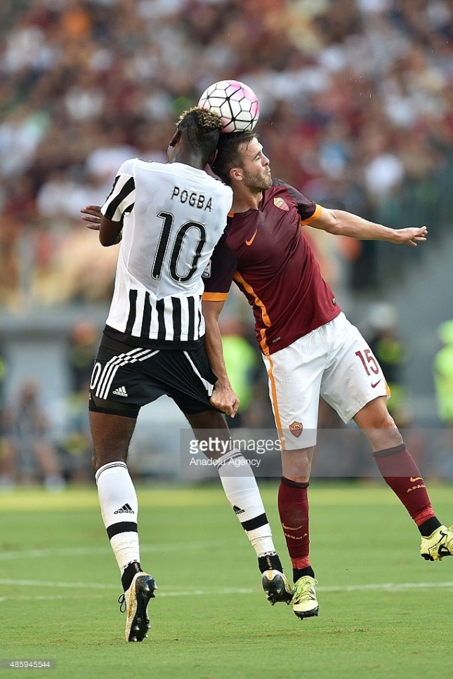 Miralem Pjanic (15) of AS Roma competes for the ball with Paul Pogba (10) of Juventus FC during the Serie A soccer match between AS Roma and Juventus FC at Stadio Olimpico on August 30, 2015 in Rome, Italy. CREDIT: ANADOLU AGENCY